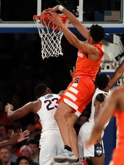 Syracuse forward Matthew Moyer dunks over Connecticut