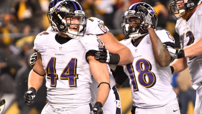 Baltimore Ravens fullback Kyle Juszczyk (44) is congratulated by teammates Breshad Perriman (18) and Alex Lewis (72) after scoring a touchdown in the fourth quarter of a game against the Pittsburgh Steelers at Heinz Field. Pittsburgh won 31-27.