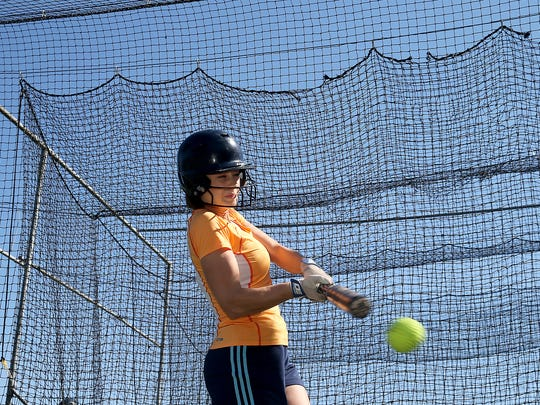 Bainbridge softball player Sara Colley hits in the batting cage during practice Tuesday.