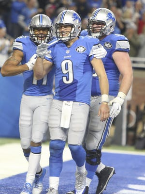"""Matthew Stafford celebrates his winning touchdown late in the fourth quarter against the Bears with Marvin Jones Jr. (11) and Graham Glasgow on Dec. 11, 2016. """"We know every game is gonna be a battle,"""" Stafford said."""