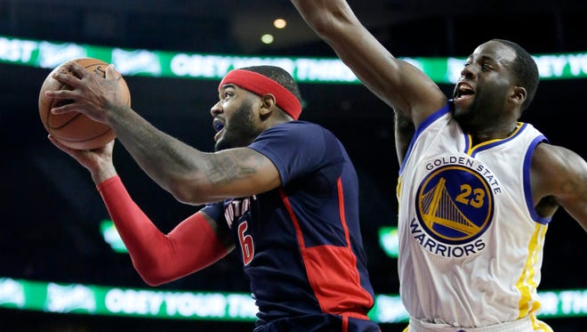Detroit Pistons' Josh Smith (6) goes to the basket past Golden State Warriors' Draymond Green (23) during the second half of an NBA basketball game Sunday, Nov. 30, 2014, in Auburn Hills, Mich. The Warriors defeated the Pistons 104-91.