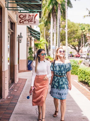 Lifestyle and fashion blogger Monica Ramos, left, and Naples Daily News features reporter Shelby Reynolds, right, shop Fifth Avenue South on Monday, Aug. 28.