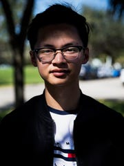 "Ethan Trieu, 17, outside of Marjory Stoneman Douglas High School on Friday, Feb. 16, 2018. Trieu, now a senior, was friends on and off with Nikolas Cruz since the sixth grade, but hadn't been in contact with him since his junior year. ""He needed a friend to cope with and he had no one. Everyone is focusing on the guns right now, but the community itself had a problem too. We couldn't help him,"" said Trieu."