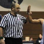 Zaim Cunmulaj referees a match during the Farmington Public Schools tournament.
