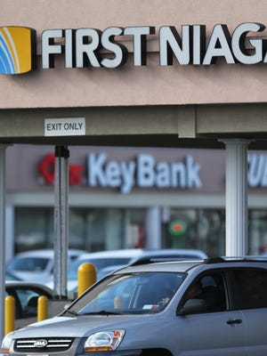 First Niagara customer can expect more information this summer how their accounts may be affected in the bank's acquisition by KeyCorp. The deal still needs regulatory approval.