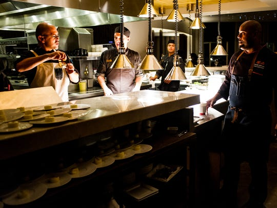 Chef Gerald Sombright watches the kitchen at Ario in