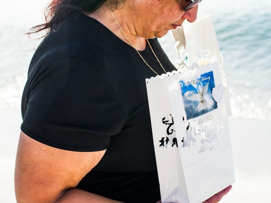 Jennie Suarez carries two luminaries at the fourth