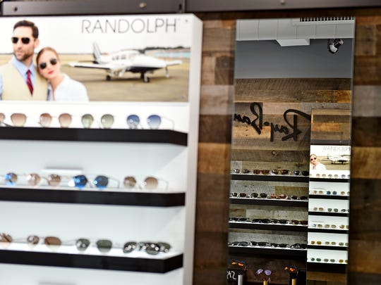 Sunglasses are displayed at Sky Optics, the North Beaver Street store Steve Arbetman and his wife Trish opened in July. Steve Arbetman is a pilot for Southwest Airlines.