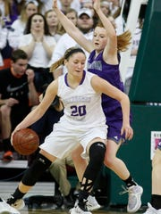 Stoughton's Hannah Hobson tries to defend New Berlin Eisenhower's Chelsea Brackmann during the first half of their WIAA Division 2 state basketball championship game.