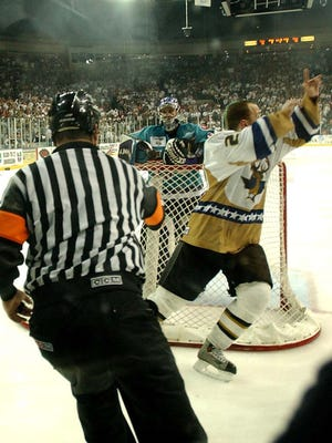 Referee Steve Cruickshank signals the game-winning goal in Game 7 of the 2004 Presidents Cup Final.
