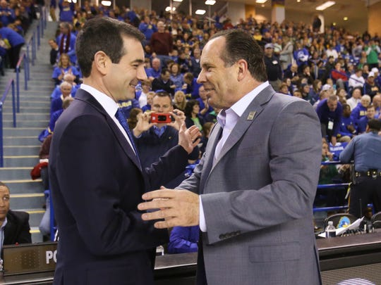 Delaware coaches present (left, Martin Ingelsby) and past (Mike Brey) greet each other before the start of the Blue Hens matchup against Notre Dame at the Bob Carpenter Center Saturday.