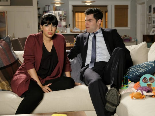 Cece (Hannah Simone), left, and Schmidt (Max Greenfield)