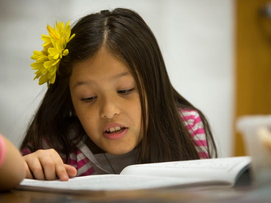 Breanna Garza, 8, completes a timed-reading exercise