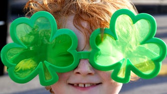 Oliver Egnatic,7, of Thompson Station wears shamrock sunglasses at the 15th Annual Main Street Brewfest on the downtown Franklin square on Saturday, March 17, 2018.