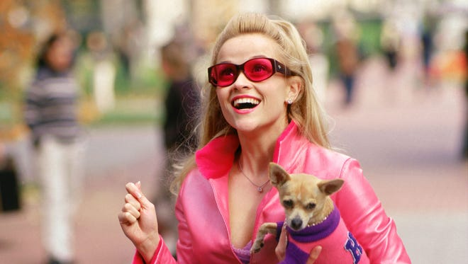 "Reese Witherspoon in ""Legally Blonde"" proving orange will never be the new pink."
