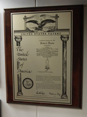 This plaque from the U.S. Patent Office on display at the Mountain Home Machine Shop denotes Bob Davis' patent for pulsing combustion. Davis was part of the design team that developed Styrofoam cups aluminum-based pans and trays.