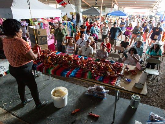 Many gather as Rocio Banuelos provides free chile ristra
