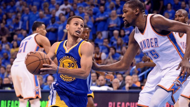 Golden State Warriors guard Stephen Curry (30) drives to the basket as Oklahoma City Thunder forward Kevin Durant (35) defends during the first quarter in Game 6.