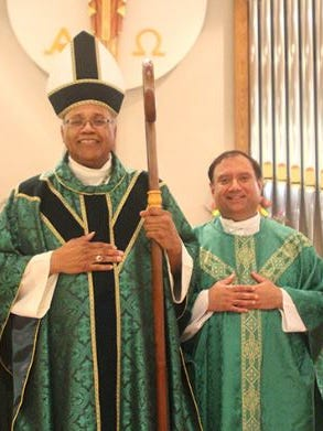 Monsignor Clement Machado, right, stands with Bishop Martin Holley of the Diocese of Memphis. Machado has resigned as the diocese's vicar general