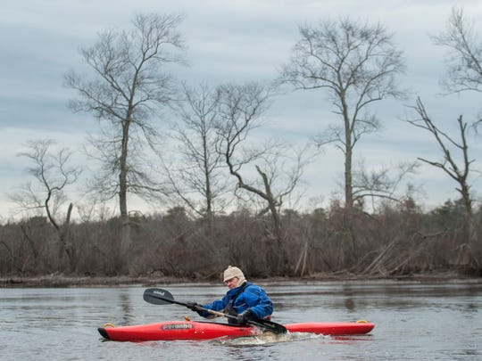 John Anderson of Westampton paddles his kayak in the Rancocas Creek in Hainesport. Anderson is behind a grass-roots effort in Burlington County to seek a federal designation for the creek as a national water trail.