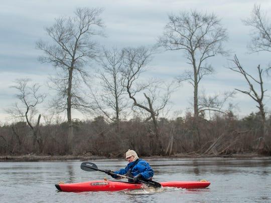 John Anderson of Westampton paddles his kayak in the