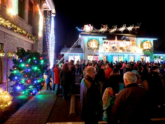 Hundreds gather for the annual Christmas Holiday Lighting Kick Off at Gatti and Gatti Law in Salem on Saturday, Nov. 28, 2015. The display will stay lit every night through New Year's Day, with Santa visits every Thursday - Sunday from 5:30 p.m. to 8 p.m. through Dec. 20.