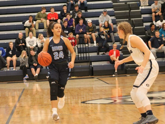 Iowa commit Gabby Marshall handles the ball for the