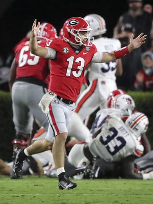 Georgia quarterback Stetson Bennett celebrates a touchdown run by Zamir White to take a 24-0 lead over Auburn during the second quarter on Oct 3 in Athens.