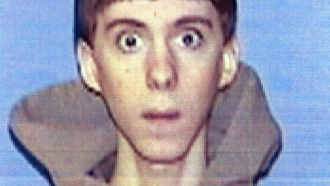 This undated identification photo provided by Western Connecticut State University in Danbury, Conn., shows former student Adam Lanza.