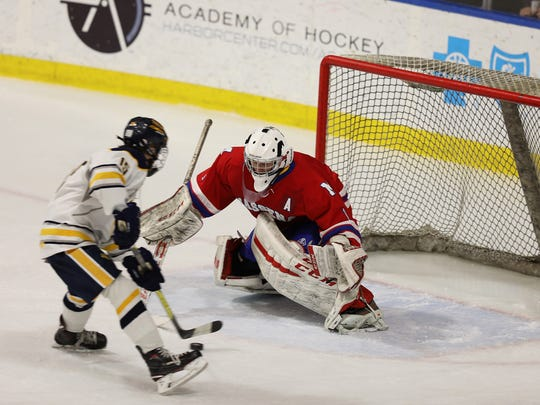 Victor's Lukas Miller breaks in on Massena goalie Nathan Moffitt, but is denied in the state semifinals in March.