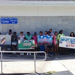 Girls with the Bonita Pueblo Boys and Girls Club display the artwork they created for the Human Trafficking Awareness Partnerships' ARTREACH program.