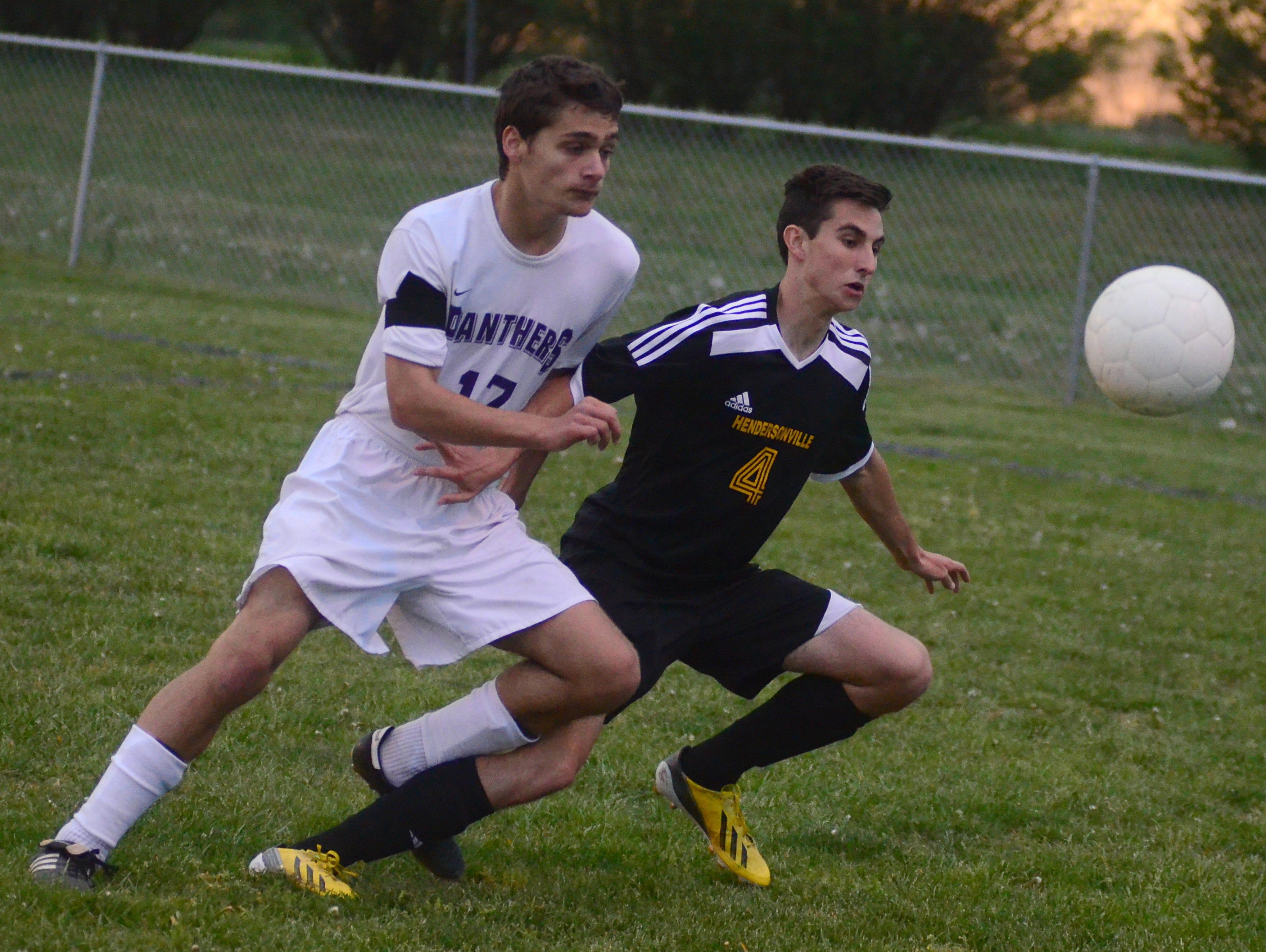 Portland High sophomore Evan Decker (17) battles Hendersonville senior Ethan Salley for possession during first-half action.