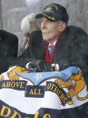 Korean War veteran Thomas Hudner looks on during the christening ceremony for the future USS Thomas Hudner, a U.S. Navy destroyer named in his honor, at Bath Iron Works in Bath, Maine, Saturday, April 1, 2017.  Hudner, a naval aviator who crash-landed his plane to try to save a downed pilot from Mississippi in the Korean War, was honored with a ship bearing his name.