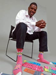 Evansville basketball coach Walter McCarty is all for players expressing themselves, like he enjoys doing with his men's luxury sock line.