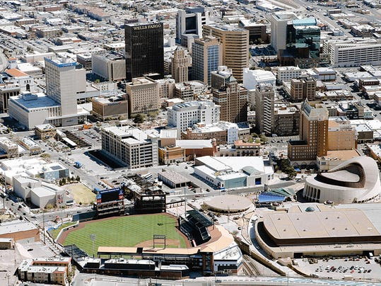 RUBEN R RAMIREZ?EL PASO TIMES The El Paso skyline with the new Soutwestern University Baseball Park which replaced the former City Hall building.