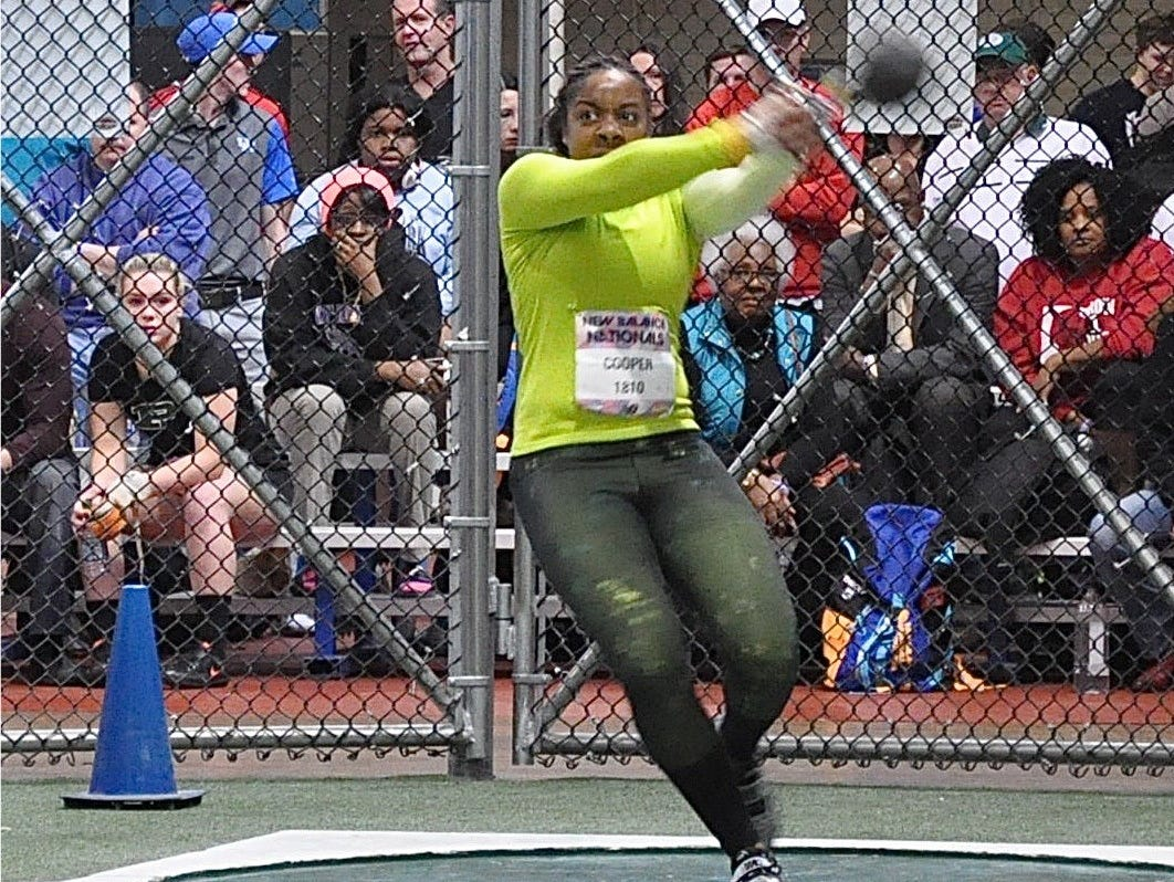 New Rochelle's Monae Cooper prepares to unleash a 51-9.25-foot weight throw during the New Balance Indoor Nationals.jpg