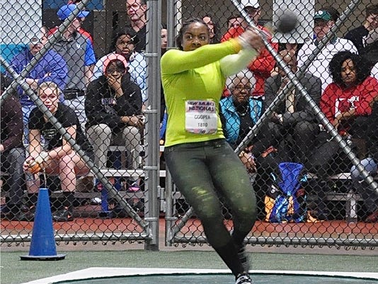 635934682600410809-New-Rochelle-s-Monae-Cooper-prepares-to-unleash-a-51-9.25-foot-weight-throw-during-the-New-Balance-Indoor-Nationals.jpg