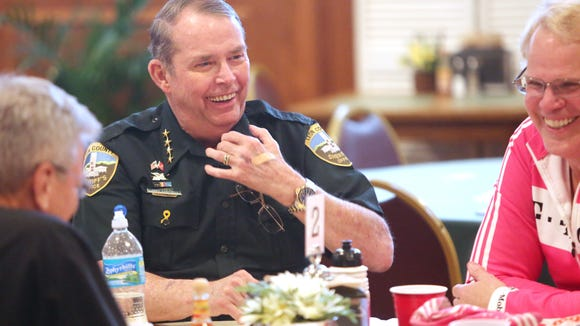"Sheriff Larry Campbell jokes during his session at one of the speed dating tables.  Leon County citizens got  a chance to get up close with some of Tallahassee's most powerful officials and influencers during the ""Speed Date Your Local Leaders"" event sponsored by The Village Square in April 2013."