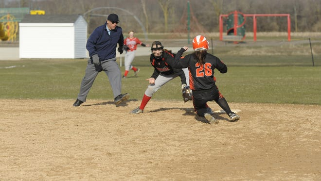 Manitowoc Lutheran shortstop Lindsay Engelbrecht goes to make the tag on Reedsville's Megan Cohen on a stolen base attempt in the fourth inning on Thursday.