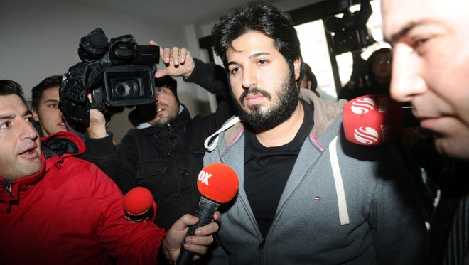 This file photo taken on December 17, 2013 shows businessman Reza Zarrab  surrounded by journalists as he arrives at a police center in Istanbul.  Zarrab arrested on March 19, 2016 in the United States on charges of conspiring to evade U.S. sanctions on Iran.