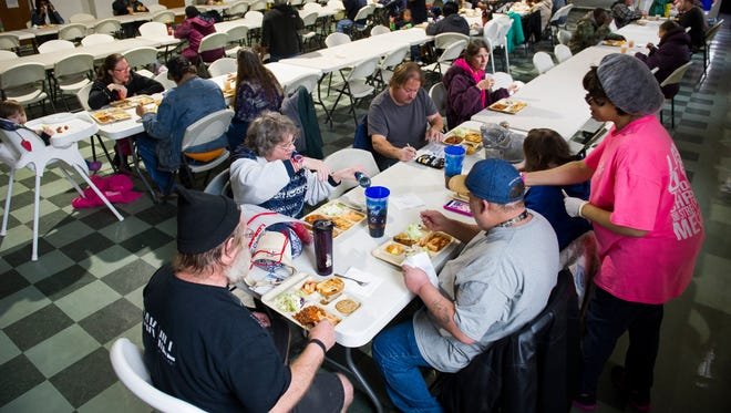 People gather for lunch at The Diner, a bi-weekly soup kitchen at PotterÕs Wheel Inner City Mission in Evansville, Tuesday, Dec. 6, 2016. Meals are provided free of charge every Tuesday from 11 a.m. to 1 p.m. and every Saturday 9 a.m. to 11 a.m.
