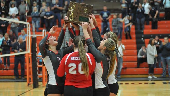 The six Buckeye Central seniors lift the regional championship trophy.