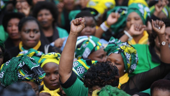 South African African National Congress Women's League members singing and lay flowers to mourn with the family outside Winnie Madikizela-Mandela's home in Soweto, Johannesburg, South Africa on April 3, 2018. Former wife of South Africa's first black president, Nelson Mandela and veteran South African anti-apartheid activist Winnie Mandela passed away in a Johannesburg hospital on 02 April 2018 at age 81. There will be a state funeral for her on April 14, 2018.