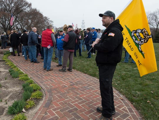 Jay Lowman of Townsend stands with his Don't Tread on Me flag during a Second Amendment rally in the Legislative Mall in Dover.