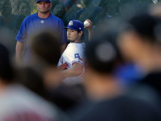 A crowd gathers around Texas Ranger pitcher Yu Darvish (75) as he throws to prepare for a rehab start for Triple-A Round Rock Express against the New Orleans Zephyrs in a baseball game, Friday, May 6, 2016, in Austin, Texas. (AP Photo/Eric Gay)