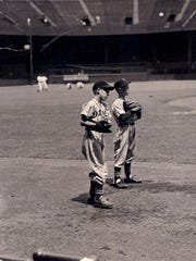 Elliott Trumbull and Mickey Briggs playing at Briggs Stadium before a Tiger game in genuine uniforms provided by Mickey's grandfather, Walter O. Briggs.