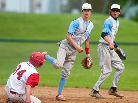 South Burlington second baseman Theo McDowell, center, turns a double play during Wednesday's Division I  semifinal against Champlain Valley.