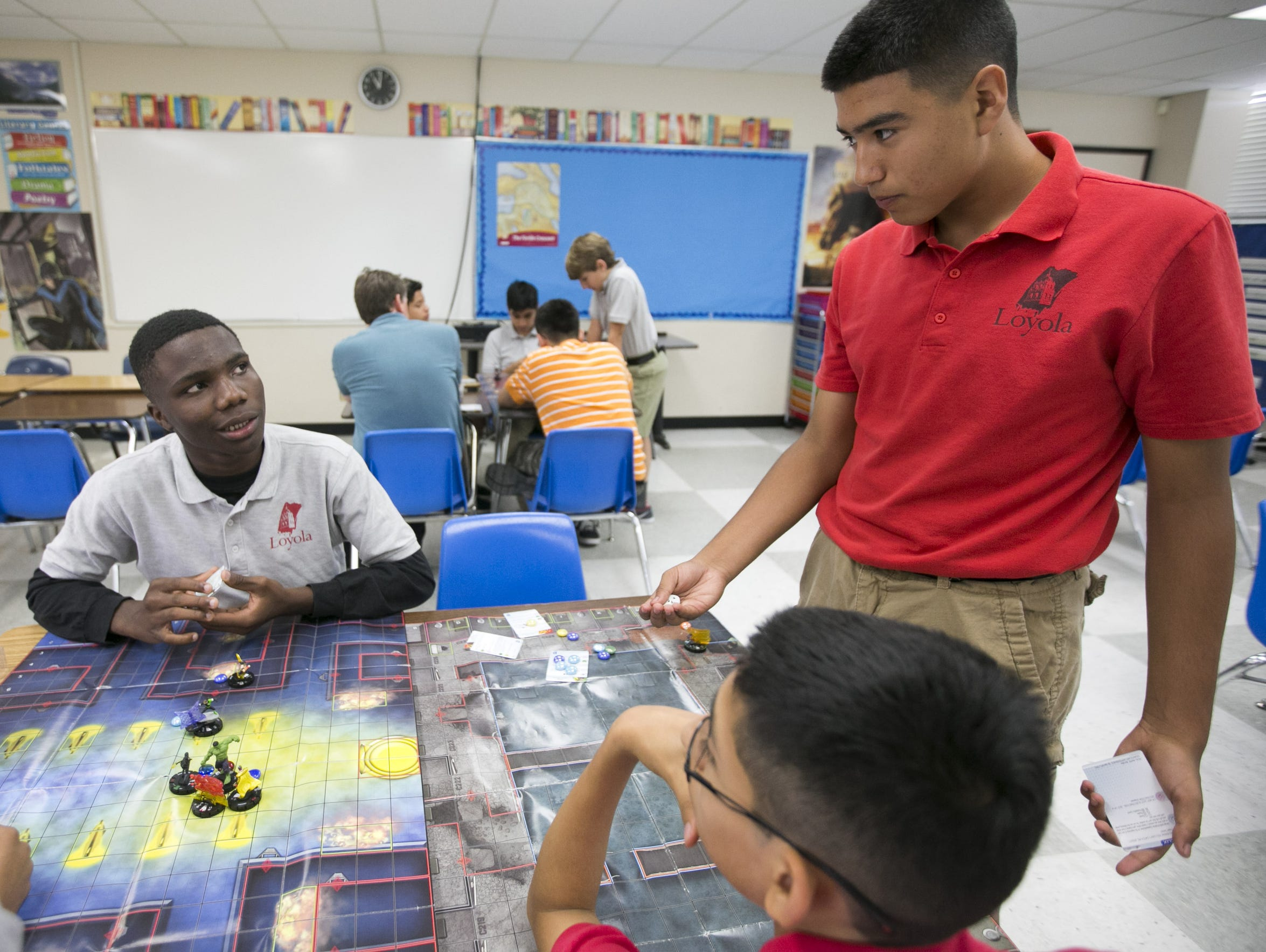 Loyola Academy eighth-graders Charles Gbekia, 14, left,