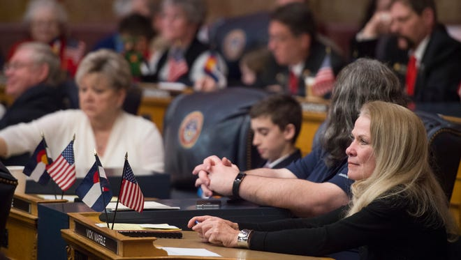 Sen. Vicki Marble, R-Fort Collins, takes her seat in the Capitol as the Colorado Senate convenes in its first session of the 71st General Assembly in Denver on Wednesday, January 11, 2017.