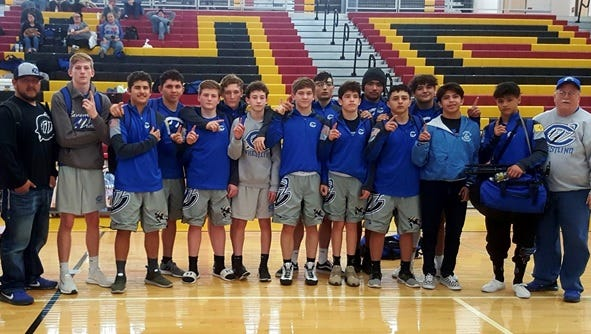 The Cavemen following a district win in Las Cruces Saturday.